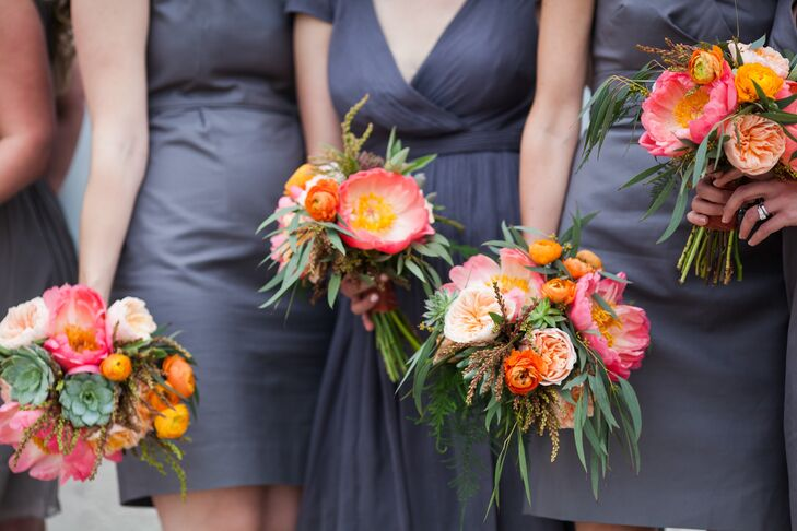The bridesmaid bouquets echoed Molly's bouquet. They carried peonies, garden roses, ranunculus, succulents, astilbes and lots of greenery. The combination of pink, orange and green set the tone for the funky, colorful wedding.
