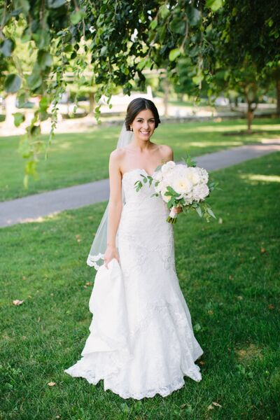 "When it came to choosing a wedding dress, Erica headed to Mariella's Creations in Wethersfield, Connecticut. She chose a classic lace gown in a strapless, mermaid-style silhouette and paired it with a fingertip-length, lace-edged veil for the ceremony. ""I had also come across photos of beautiful vintage-inspired crystal hairpieces and wanted something a little different from the expected hair comb,"" Erica says. ""I found a shop on Etsy in Italy and ordered the hairpiece from a woman who makes them by hand."""