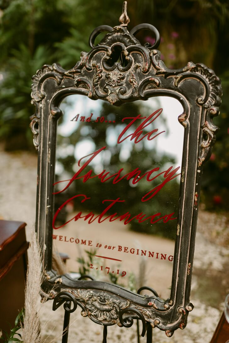 Vintage Mirror Sign with Red Calligraphy