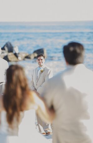 Groom Happily Awaits His Bride at the Shoreline
