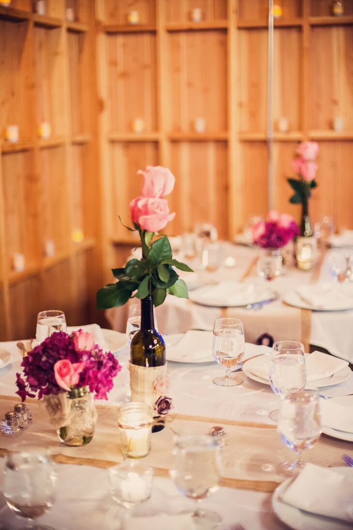 The centerpieces included pink roses and hydrangeas in burlap-wrapped wine bottles and lace-wrapped mason jars.