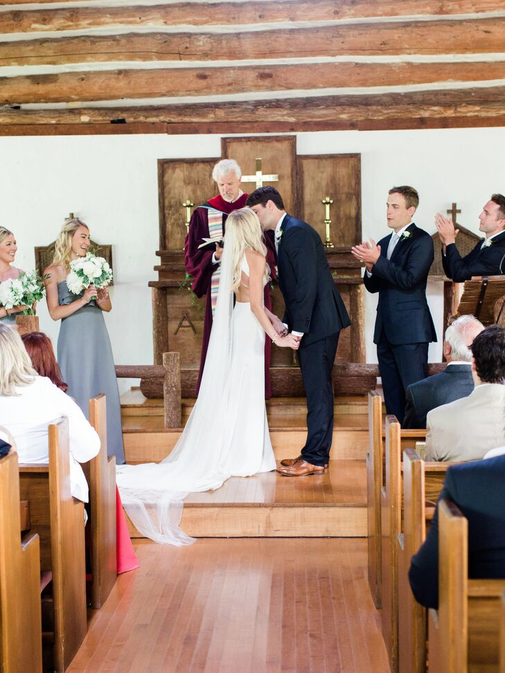 First Kiss at Rustic Chapel Ceremony