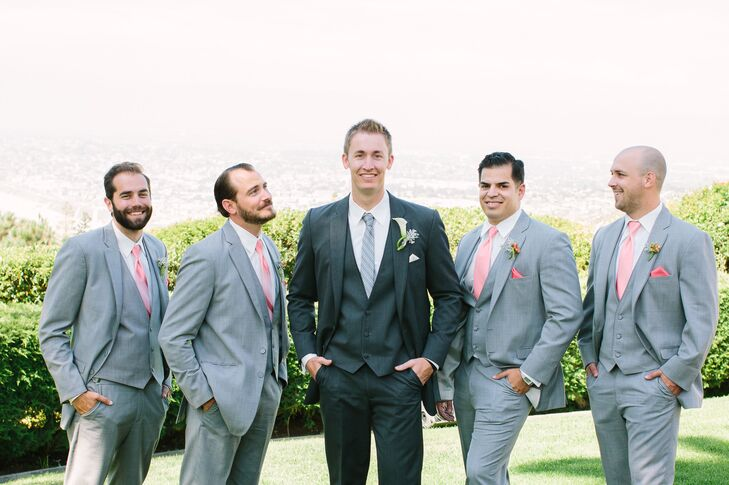 """""""Jeff wore an Allure suit in Steele grey with a charcoal cravat striped tie,"""" says Brittney. """"The groomsmen wore the same suit, but in a lighter Heather grey with a coral savvi solid, ombre tie and pocket square."""""""