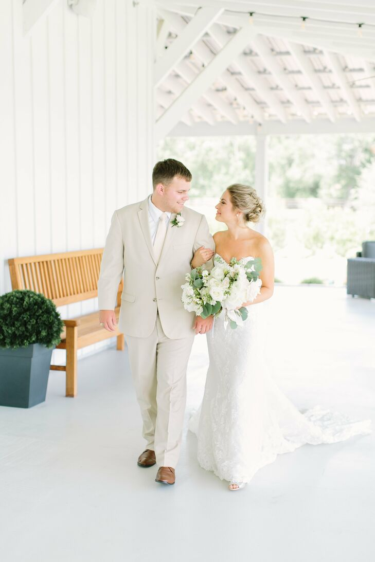 Taylor Kay (22 and self-employed) and Jacob Moore (23 and a gym teacher) threw a barn bash full of organic greenery, blush tones and gold accents that