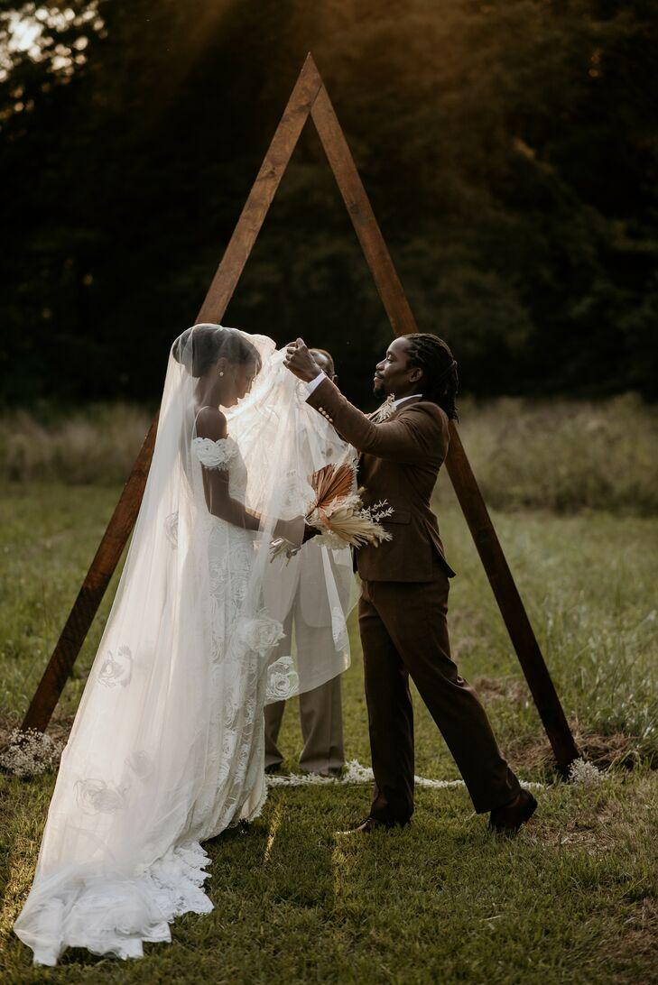 Groom Lifting Veil During Wedding Ceremony in Durham, North Carolina