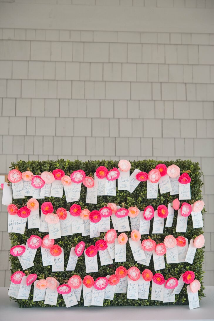 The escort cards featured water color calligraphy from Perch Paper Company tied to mini handmade paper flowers from Land Of Flowers. The calligraphy cards were attached to a faux-birch hedge with gold clothes pins for a whimsical look.