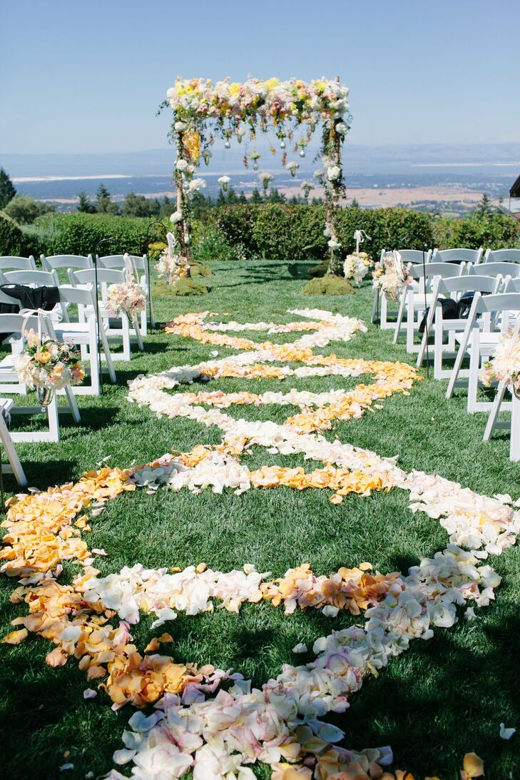 Scenic Winery Ceremony Site with Floral Wedding Arch