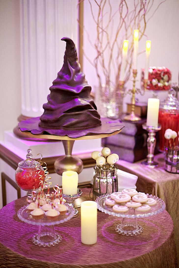 The groom's cake was the sorting hat from Harry Potter since Billy is a huge fan. It was displayed on a table with cake pops and cookies that had the same magical inspiration.