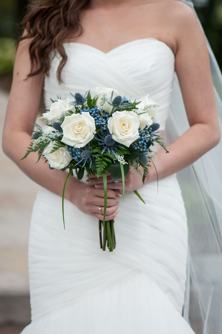Nicole used white roses in her bouquet and blue thistle to tastefully imitate peacock feathers. A wide assortment of other flowers were used for other members of the wedding party, including calla lilies for the bridesmaids, orchid wristlets for the mothers, and blue-green hydrangea wristlets for the godparents.