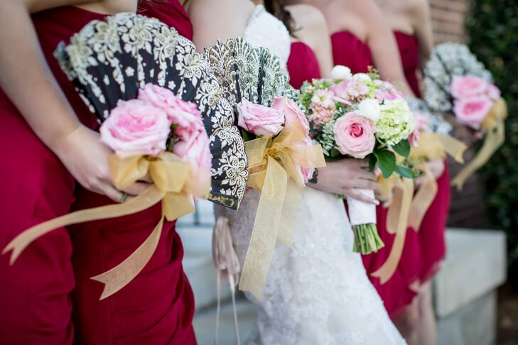 The bridesmaids, dressed in red, carried black and silver Spanish fans with fresh roses—a nod to Jonatan's heritage.