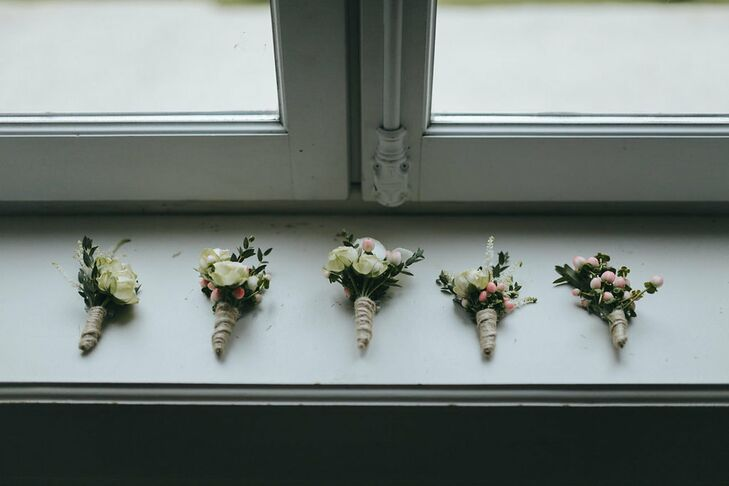 Boutonnieres, like the rest of the floral arrangements, consisted of pastel blooms designed in Burgundy, France.