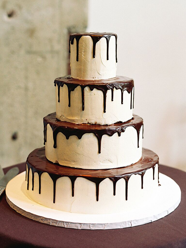 Simple four-tier wedding cake with a chocolate drizzle design