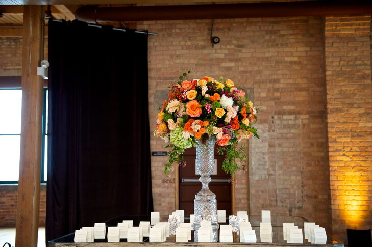 Escort Card Table with Warm Summer Flowers