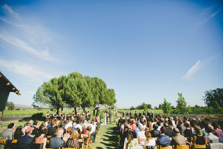 "Choosing Etude Winery, which they visited on one of their first dates, as the location for their wedding added an extra special element to Robyn and Tony's wedding day. The pair hosted their ""I do's"" on Etude's expansive lawn overlooking the acres of lush landscaping and the Sonoma Mountains in the distance."
