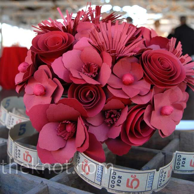 In lieu of traditional flowers, Carrie carried a bright red bouquet of paper blooms, designed by the matron of honor.
