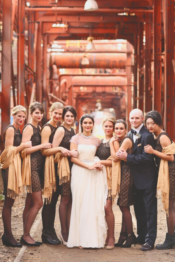 The bridesmaids wore patterned, fitted black sheaths from Anthropologie with gold pashminas.