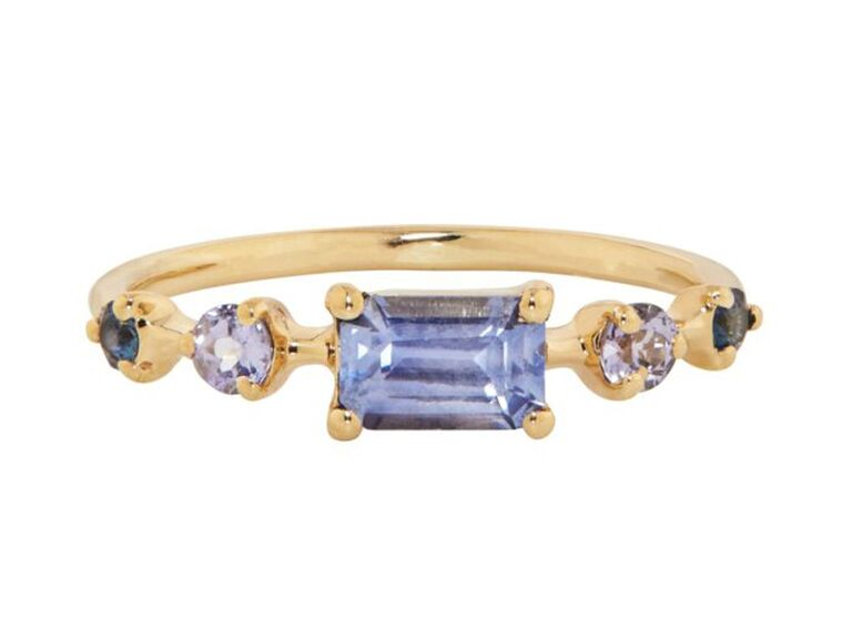Multi-stone sapphire engagement ring on yellow gold band
