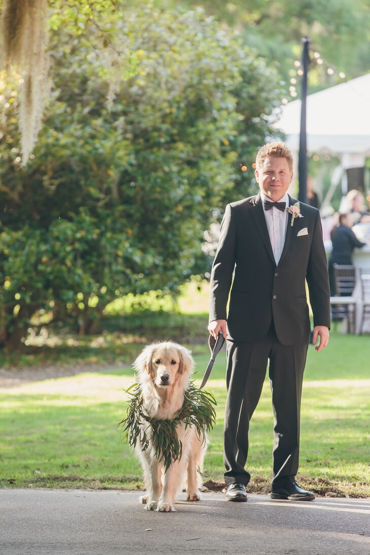 David wore a classic, black Brooks Brothers suit paired with a white Thomas Pink shirt and black bow tie. The beautiful pink ranunculus and dusty miller greenery boutonniere added a softness to the ensemble. Their dog, Buddy, wore green leaves around his neck.