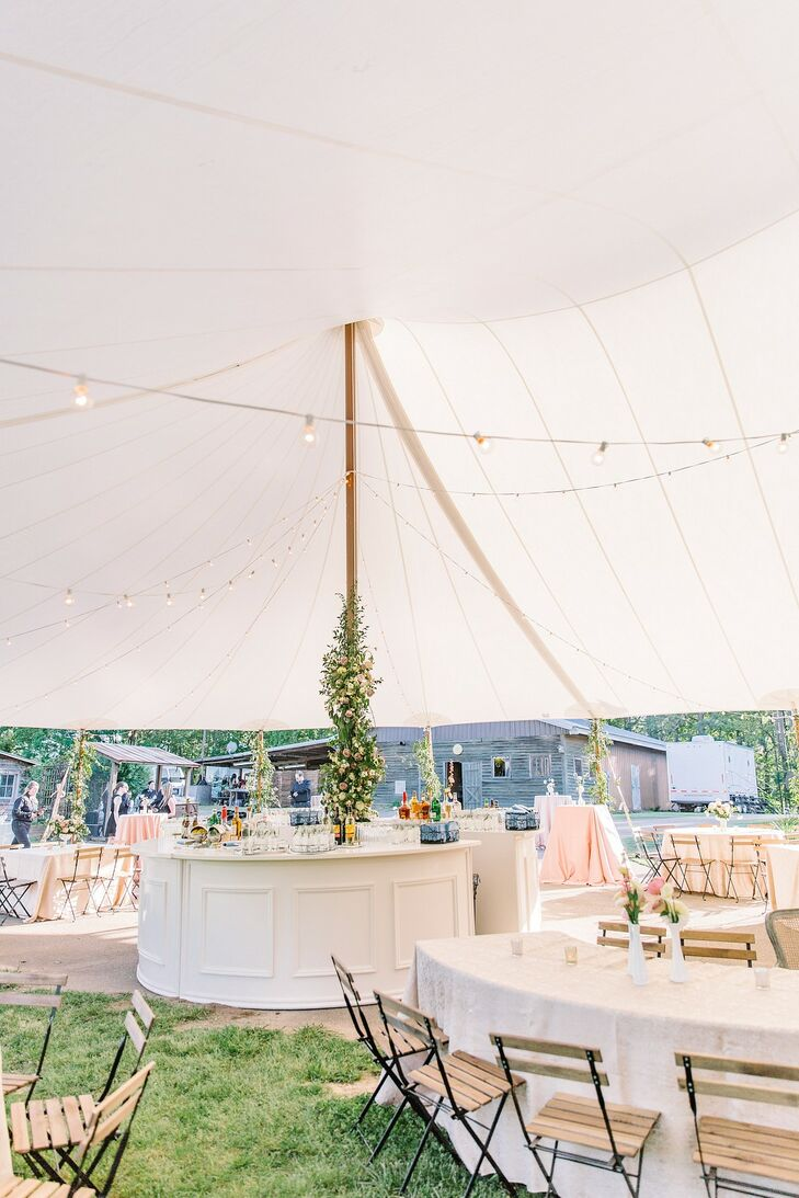 Whimsical Tented Reception with White Bar, Dining Tables and String Lights