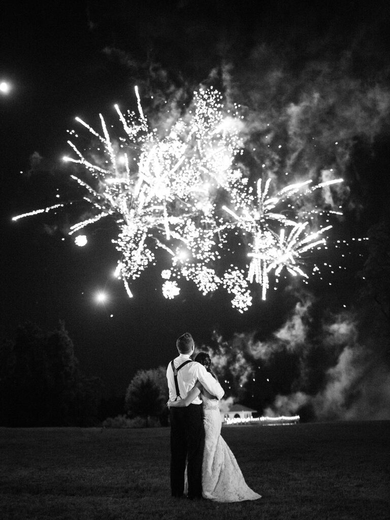 Couple looking at fireworks during reception