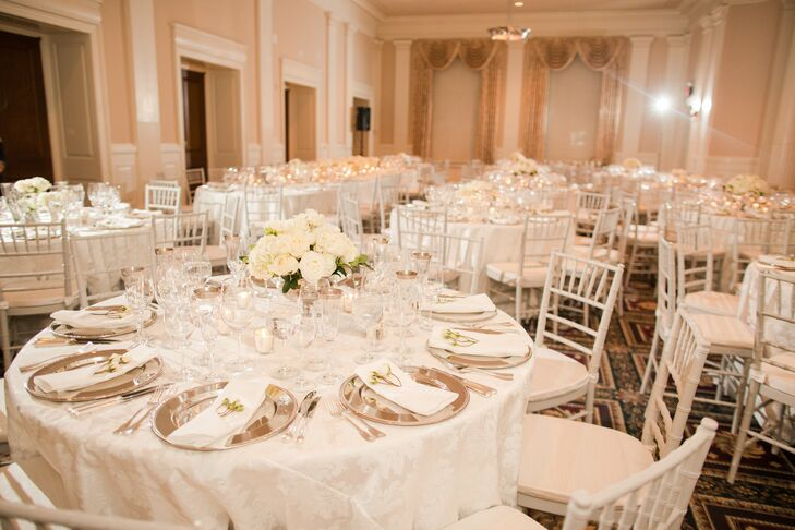 The reception was held in a ballroom at the Carnegie Institute of Washington. Round dining tables were arranged with white table linens and white chiavari chairs for this timeless event.