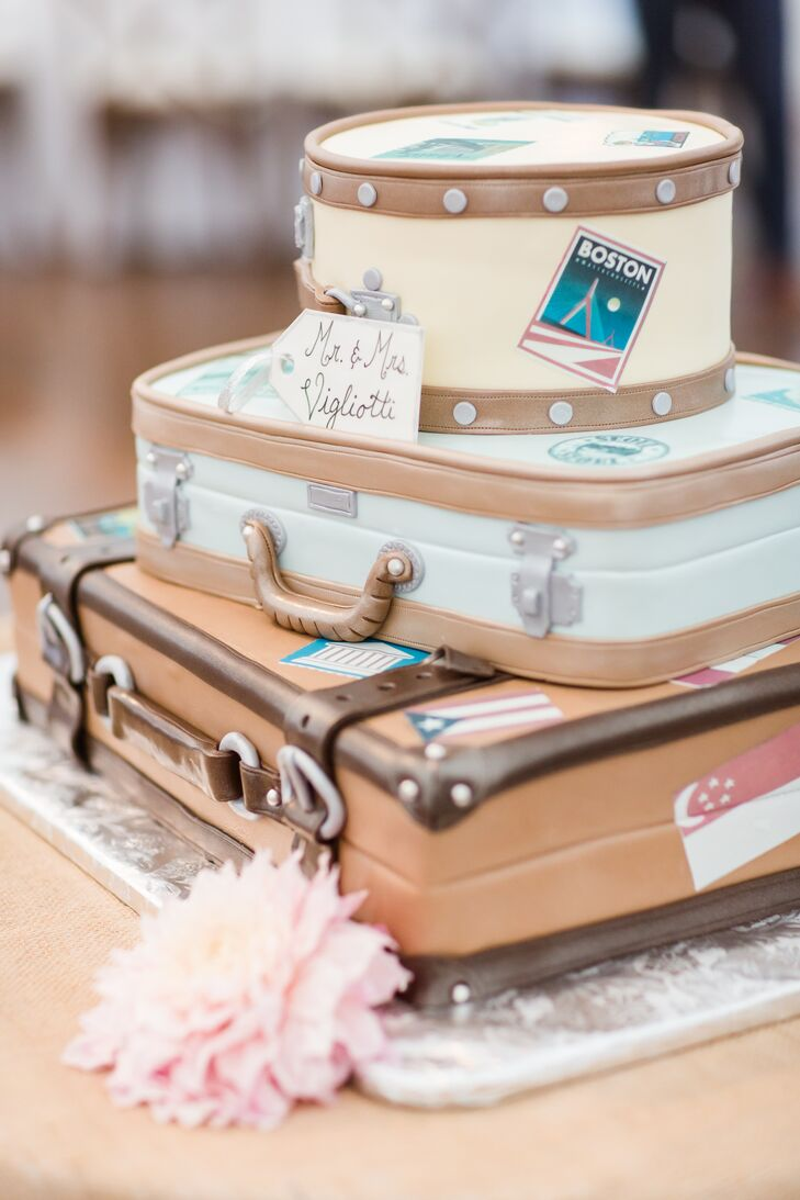 "Wilson Farm surprised Jennifer and Nick with an over-the-top travel-inspired wedding cake. Each tier of the inspired confection had both vanilla and red velvet cake and was designed to look like a suitcase, complete with buckles, handles and stickers that reflected the places the couple had visited together. ""The cake was so incredible; it almost looked real,"" Jennifer says. In addition to cake, the couple served Kimball Farm ice cream, Jennifer's favorite."