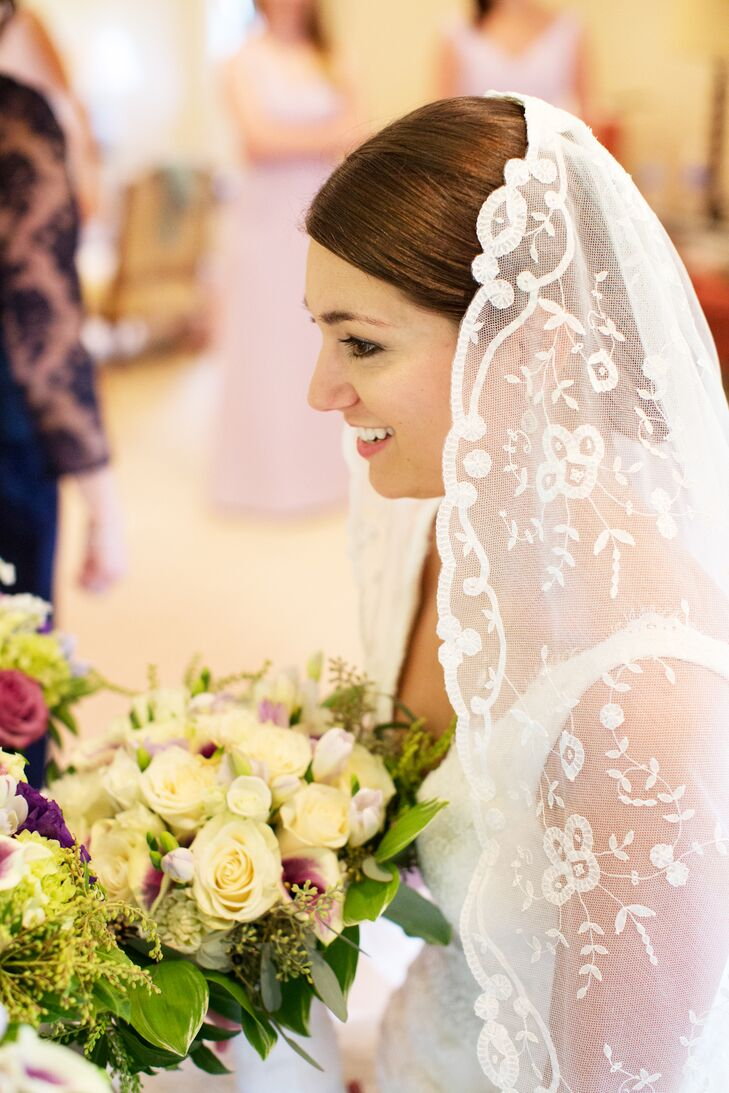 Bernadette wore a lace veil that was purchased by her great aunt in 1956 while vacationing in Belgium. The family heirloom veil has been worn by nine brides, including Bernadette's mother and grandmother.