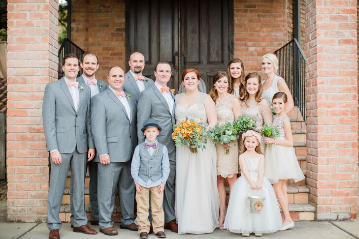 Alison and Pierce's neutral wedding party attire allowed for the Gallery's organic beauty and the bright orange and green floral arrangements to stand out.
