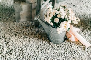 Rustic Watering Can Filled with Light Pink Roses and Peonies