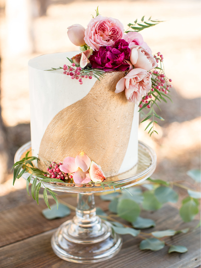 simple wedding cake with gold paint