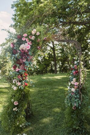 Outdoor Ceremony Arch with Flowers and Greenery
