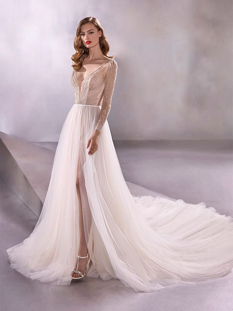 Atelier Provonias wedding dress long-sleeve dress with beaded bodice and tulle skirt
