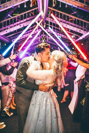 Couple Kisses Under Light Saber Arch at Star Wars-Themed Wedding