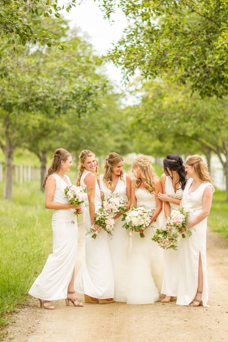 Each bridesmaid chose her own dress within the white, floor-length aesthetic.
