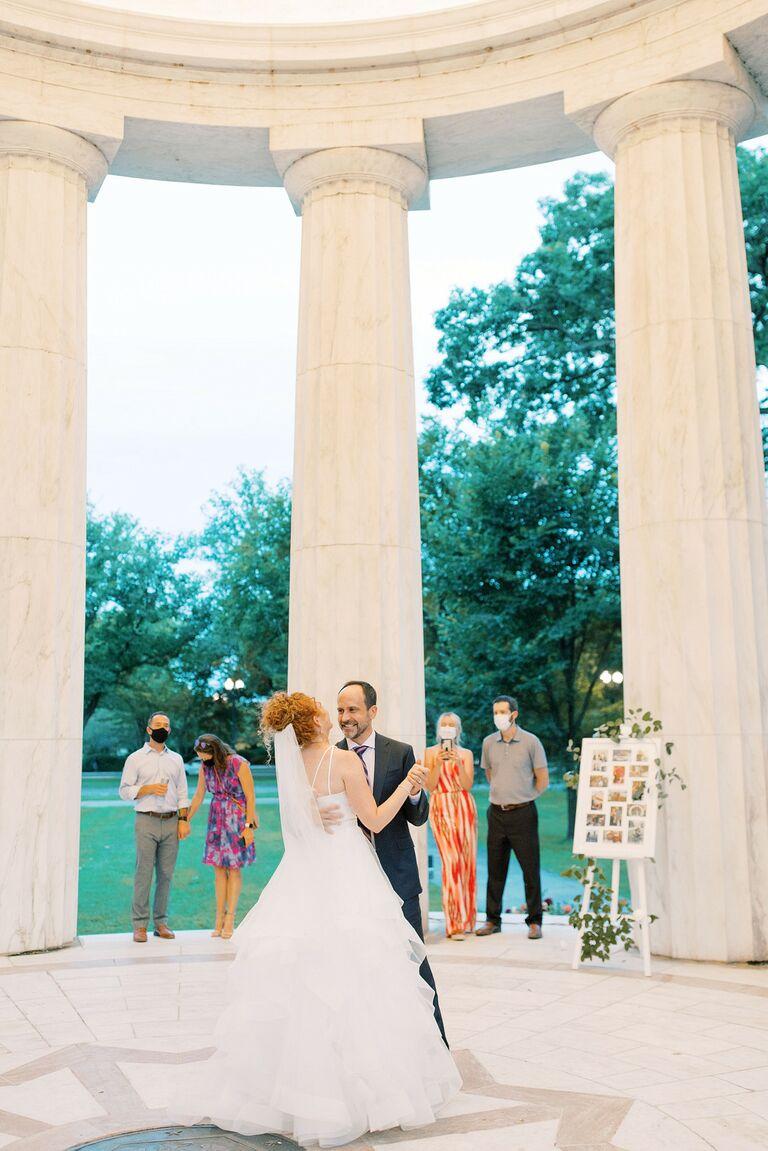 Couple sharing first dance at Washington D.C. War Memorial