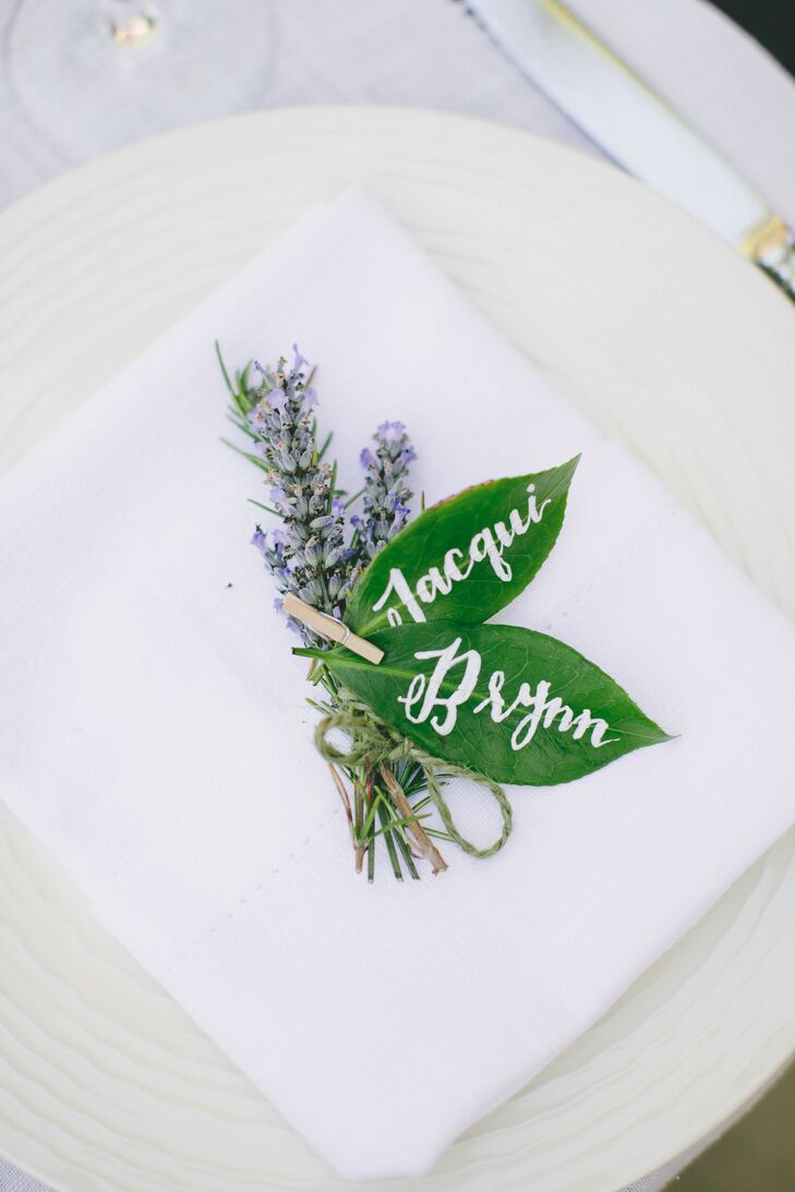 Escort cards were created from leaves with the names of guests and their table numbers written in calligraphy on each.