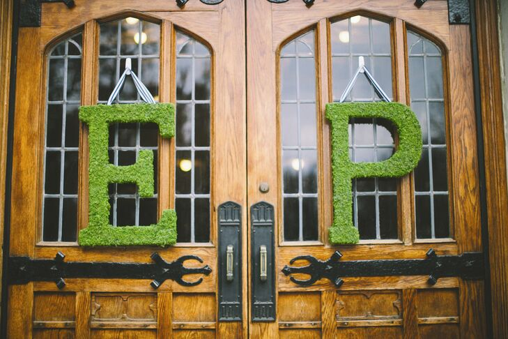 Large moss-covered Initials hung outside the church doors.