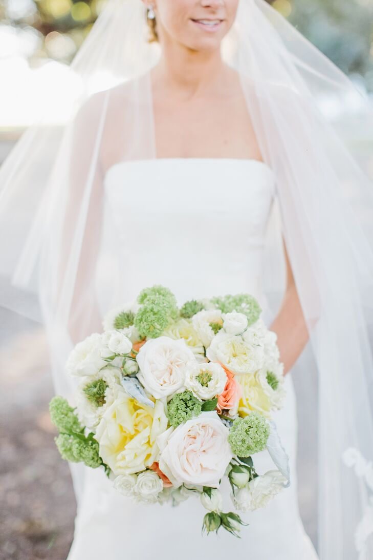 Colleen incorporated pops of color into her oversized bouquet with lush clusters of garden roses, dusty miller and green vibernum.