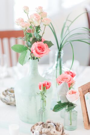 Coral Rose Centerpiece in Blue Sea Glass Vase