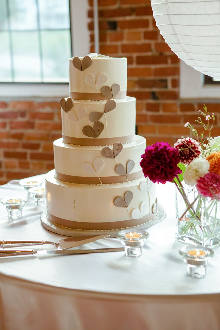 The four tier white cake had brown and white hearts cascading down the side.