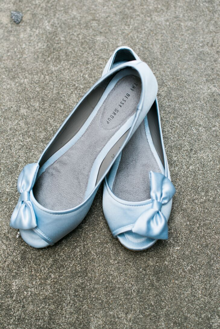 """For her """"something blue,"""" Ginnie wore light blue peep-toe flats with bows on the sides. They were not only an adorable touch to her style, but also allowed her to stay comfortable all day."""