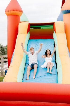 Bride and Groom on Inflatable Slide