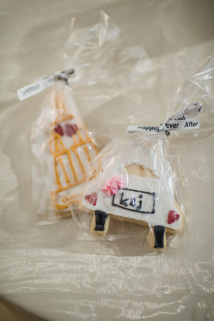 Cute frosted cookies were given to guests as sweet treat favors.