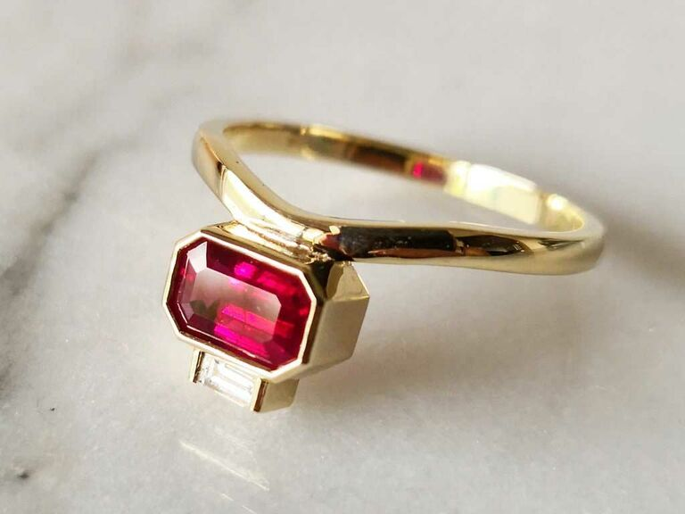 Octogonal-cut ruby engagement ring with baguette diamond