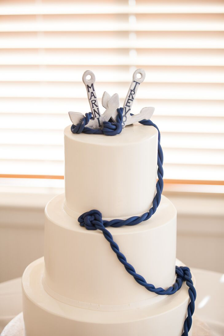 A blue fondant rope led up to white anchors at the top of the couple's nautical inspired cake.