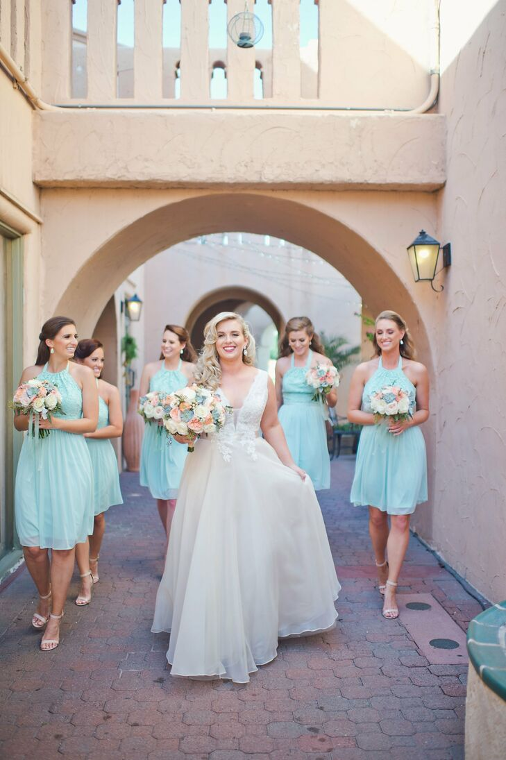 """To keep with a central goal of comfort, Liz chose knee-length dresses. """"I opted for knee-length dresses that I knew my girls would be able to dance in all night. After the ceremony, they quickly changed from their nude heels to white Keds sneakers."""""""
