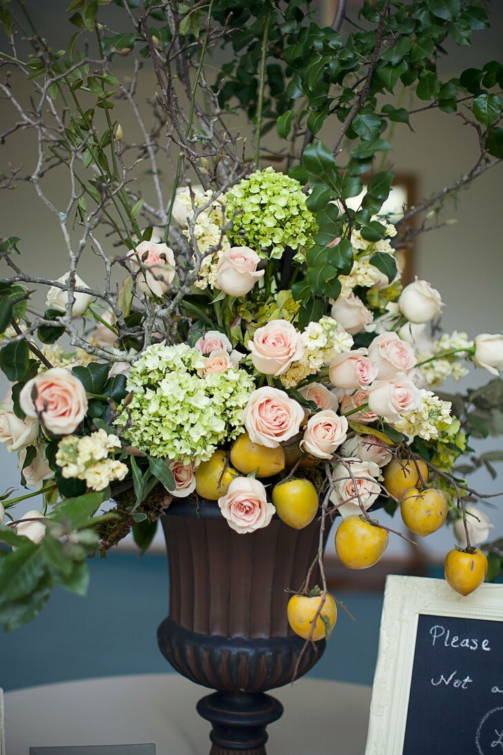Bright yellow tomatoes added a unique rustic touch the elegant floral arrangements.
