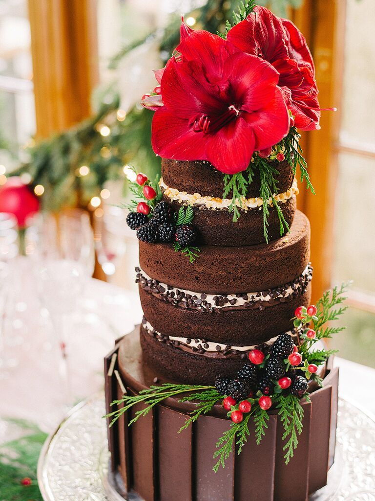 Chocolate wedding cake with berries and amaryllis