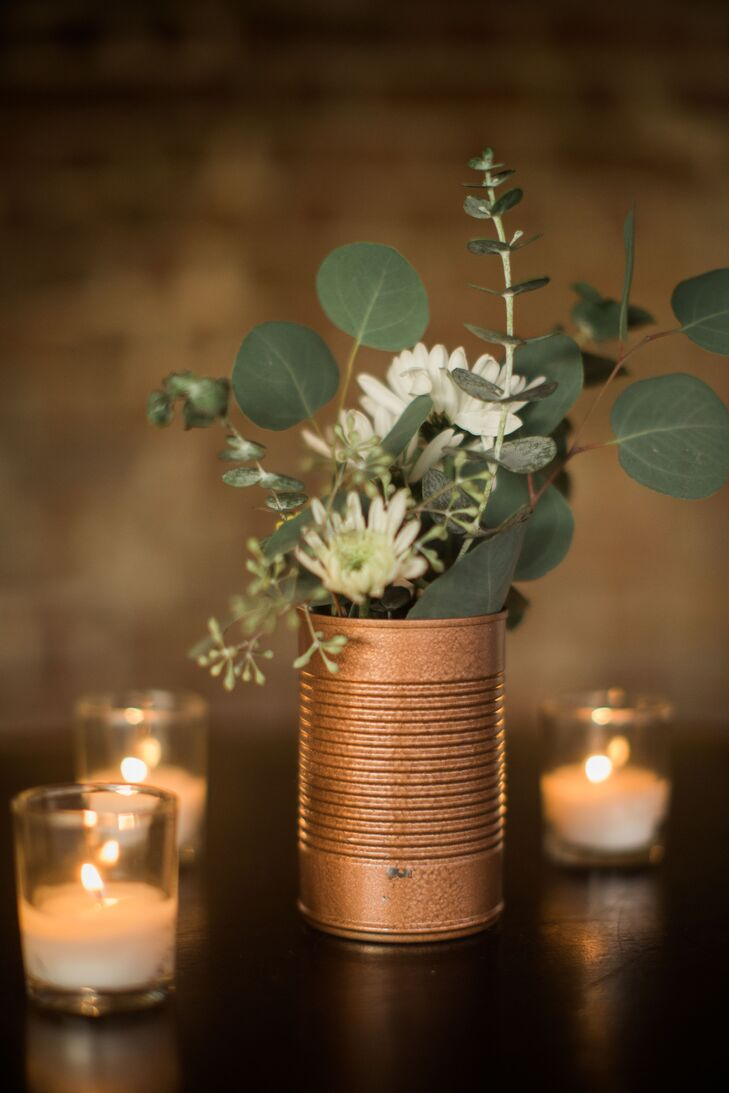 """Keeping in line with our budget, we had friends and family collect soup cans,"" Charlee-Ann says. Although it was an unusual request from a bride, Charlee-Ann had a plan to spray-paint the cans an elegant copper color and use them as vases for the reception table centerpieces."