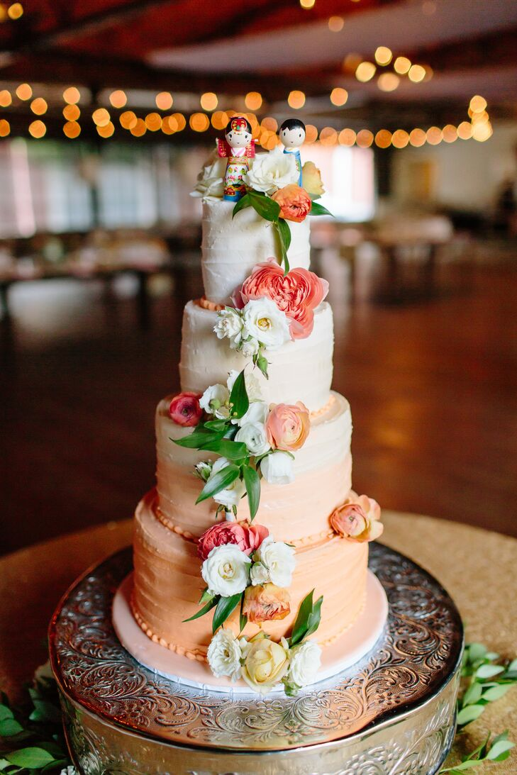"""""""We actually had two cakes,"""" Deborah says. """"We had a beautiful four-tier red velvet, peach ombre bridal cake with cream cheese filling. Our cake topper was specially created by my talented mother, who was inspired by our Korean cultural wedding attire. Steve got a chocolate cake with buttercream filling and fondant with the New York Mets logo."""""""